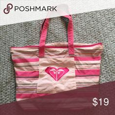 Roxy canvas beach bag Roxy pink striped tote bag, features Roxy logo on outer pouch pocket. Canvas, zip closure, also has inside zip pocket. Roomy & comfortable wide straps. GUC. Roxy Bags Totes