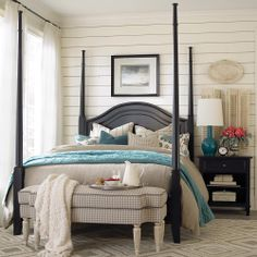 Beige and turquoise bedroom with 'Chatham Poster Bed' in antique black by Bassett