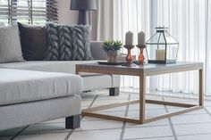 Living room coffee table, sofa and area rug Living Room Furniture Layout, Great Plains, The Prestige, Master Bedroom, Hardwood, Area Rugs, New Homes, Sofa, Dining