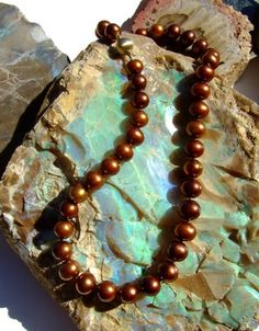 chocolate pearls on turquoise  Found mine yesterday! Cute with pink too.