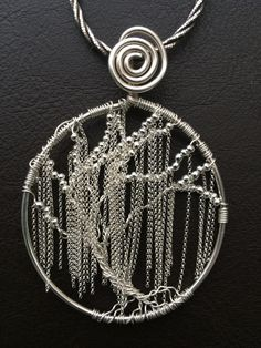 I love the way the chain hangs making this tree of life resemble a Weeping Willow.