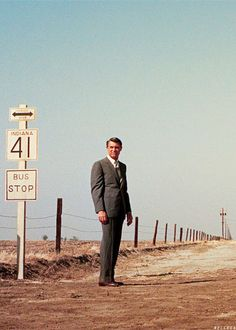 Cary Grant in North by Northwest (1959). About to have one of the most memorable scenes in movie history.