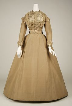 Dress Date: 1865–69 Culture: American Medium: silk Dimensions: Length (a): 15 1/2 in. (39.4 cm) Length (b): 56 in. (142.2 cm) Length (c): 17 1/2 in. (44.5 cm)