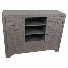 """Add vintage-inspired appeal to your living room or master suite with this 2-door, 1-drawer chest, showcasing decorative nailhead trim and 2 open shelves.  Product: CabinetConstruction Material: Burlap, wood and metalColor: NaturalFeatures:  Vintage-inspired designTwo doorsOne drawer Nailhead trim Two open shelves  Dimensions: 36"""" H x 48"""" W x 16"""" D"""