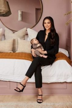 Discover TV Star Shay Mitchell cheeky nursery room decor. With  a lavishing soft rose wall tone, splashed with metallic and retro accents this baby room will inspire your design.   #circumagicalfurniture #magicalfurniture #kids #kidsroom #kidsbedroom #kidsinteriors #kidsinteriordecor #kidsfurniture #kidsroomdecor #kidsmirror #kidsideas #interiordesign #luxurydesign #interiordesigner #architecture #bedroomdecor