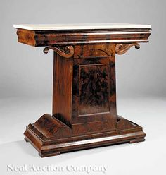 An American Classical Mahogany Mixing Table, c. 1825, attributed to Anthony G. Quervelle, Philadelphia, white marble top, ogee frieze, on scroll brackets, paneled trapezoidal door, stepped plinth, block feet, height 34 in., width 36 in., depth 17 1/2 in. $2500/3500