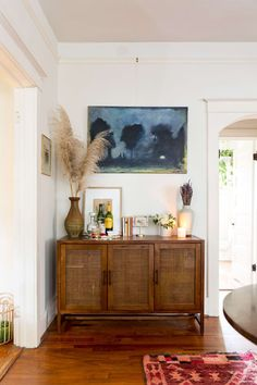 Painter Chambers Austelle's Art-Filled Charleston Bungalow - The credenza is full of family heirlooms and Christmas cocktails. Living Room Inspo, Living Room Credenza, Decor, Credenza Decor, Home And Living, Home Living Room, Interior, House Interior, Room Decor