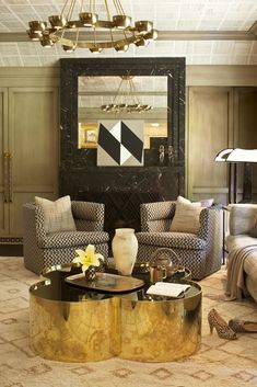 Quatrefoil coffee table. Kelly Wearstler pulls out her gold metallic magic wand in this super chic, modern living room.
