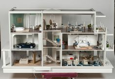 Here is one of the 10 custom dollhouses featured in the Designer Dollhouse Showcase  at the Kaleidocsope Ball that helped to raise almost $1...
