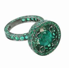 Emeraudes, Boucheron. Such an unusual design with the emeralds in the band.  B.