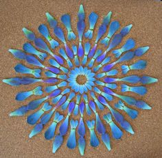 http://www.thisiscolossal.com/2012/06/flower-mandalas-by-kathy-klein/