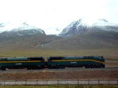The World's Highest Railway Train: Qinghai-Tibet Express zooming past. Click photo to read my blog post on Namco Lake, Tibet.