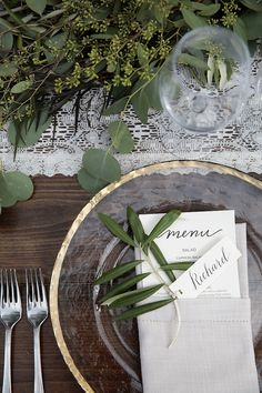 Menu will be tucked into hemstitch napkin, herb with placecard attached, same gold rimmed hammered glass charger