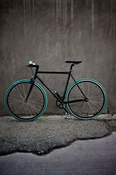 Black single speed bicycle with green tires. A stylish and Eco friendly way to get to work.