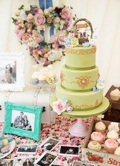 Green three tiered vintage wedding cake