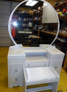 waterfall vanity with round mirror painted pearl white