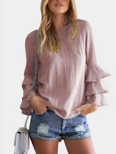 Pay your attention to this top! It features lightweight fabric, round neck and long flared sleeves. Pair it with white jeans and platform shoes for your date.#top