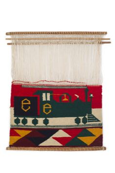"Navajo pictorial weaving sampler of a train with the letter ""E"", 1885-1890. From the Lucke Collection."