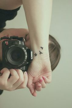 Tiny birds on wrist im obssessed with bird tattoes <3