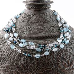 Long, double-strand necklace made with aquamarine, crystal quartz, faceted fire-polished Czech glass beads and antiqued silver-plated beads and elements. Can also be wrapped around the head and worn as a four-strand choker. By Artigiana Designs, $44.50