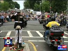 """The """"Lone Marine"""", SSgt Tim Chambers (Ret.) stands tall and salutes during Rolling Thunder 2011 in Washington, D.C."""