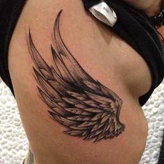 34 Wing side tattoo wrapped around wrist