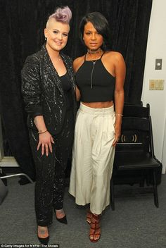 Friends in high places! Christina Milian flashed her toned tum as she posed with the violet-haired TV personality