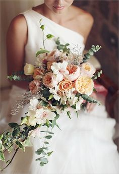 This bouquet featuring Juliet garden roses and eucalyptus leaves is unexpectedly asymmetrical | Brides.com