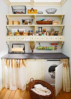 Use a counter over your washer/dryer add cabinets to double laundry room as a craft room.
