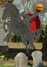 Headless Horseman (Version 1) 8' Plywood Silhouette Yard Decoration. Pumpkin is a Funkin #5. At night, it was backlit with red spot lights.