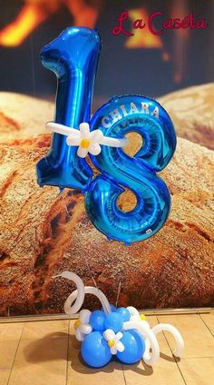 Hmm, how did that huge loaf of bread get behind the balloon number?