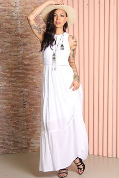 A charming bohemian dress by Somedays Lovin in white, featuring a comfortable, relaxed fit and sleeveless design. Maxi length, small keyhole cut-out on the front and ladder lace inserts.