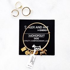 Alex and Ani Monopoly Dog Rare and Recently sold out! Alex and Ani Monopoly Dog Charm Rafaelian Gold Finish Loyalty • Companionship • Love Brand new with Tags, info card & dust bag. Product Details: An eternally loyal friend and playmate, a dog holds an irreplaceable spot in your heart. A dog possesses an affectionate nature and a love of life that is contagious. I do bundle discounts! P͜r͜i͜c͜e͜ i͜s͜ f͜i͜r͜m͜ u͜n͜l͜e͜s͜s͜ b͜u͜n͜d͜l͜e͜d͜. Great holiday gift, I ship ⚡️ Alex & Ani Jewelry…