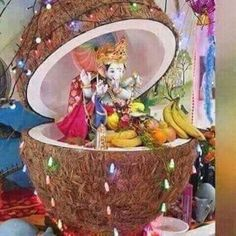 creative ideas for ganpati decoration at homewith cocounut shell Image source:pinterest