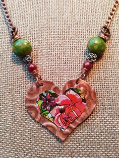 21 inch necklace made from a recycled tea tin and copper pipe  colored beads added for accent  Heart is 1.75 inches wide x 1.5 inches tall  I use a variety of recycled and repurposed materials to create unique earrings, necklaces and bracelets. Tea, cookie and vintage tins are cut and shaped to make bold designs. I also use reclaimed and scrap metals such as copper, aluminum and silver serving trays and transform them into jewelry pieces. Combining these elements with repurposed beads…