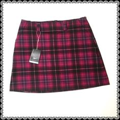 NIKE Plaid Golf Skirt Has two side pockets and two back pockets. With short shorts as lining. Nike Skirts