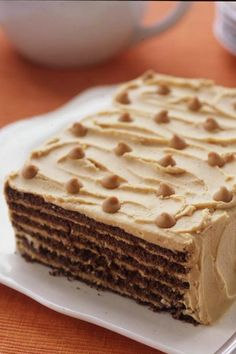 This no-bake Chocolate-Peanut Butter Refrigerator Cake spares no indulgences, piled high with six layers of peanut butter cream and chocolate graham crackers.
