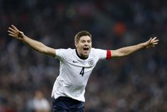 England's Steven Gerrard celebrates after scoring the second goal against Poland during the World Cup 2014 Group H qualifying football match between England and Poland at Wembley Stadium in north London on October 15, 2013. England won the game 2-0