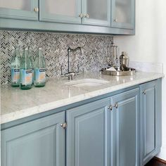 Transitional colors are another way to compromise when it comes to bold cabinet colors.
