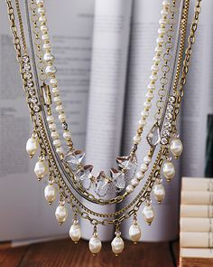 """$149.00   Practical Pearls Necklace    NEW   $149.00   With two removable strands, this five-stranded stunner can wake up a basic tee or pretty up your LBD. Glass Pearl, Swarovski crystals, Brass.    Item Number:  KRN0010    Adjusts:  20""""-22""""    Materials: Brass   Glass Pearls   Swarovski™                                         NEW                                $149.00                                 ..."""