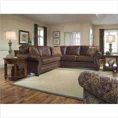 Broyhill Laramie 2 Piece Sectional Sofa with Cherry Wood Finish - Three – or more – is never a crowd at your place. Laramie's sectional sofa brings the crowd together for special gatherings and gives you plenty of room to relax.