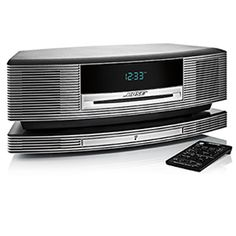 Indulge in the Wave SoundTouch music system from Bose. The Wave SoundTouch system easily connects to your home Wi-Fi, expands easily and comes with a handy remote. Sound Speaker, Stereo Speakers, Wireless Speakers, Bluetooth, Waves Audio, Gift For Music Lover, Music System, Audio Player, Speaker System
