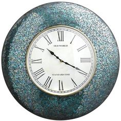 """The Peacock Mosaic Clock features a lovely roman face with intricately arrayed glass mosaic in the colors of a peacock's proudest plumage. 24""""Dia x 2""""H. $119 Sale $99.99. Buy here."""