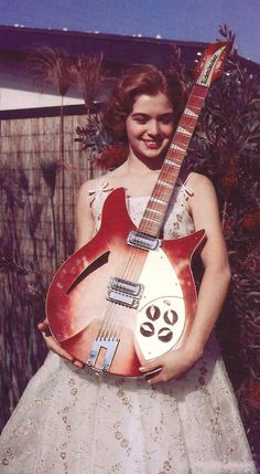 Vintage photo, MUSIC STRINGS OF HISTORY. RESEARCH #DianaDee - 1963 Rickenbacker 360-12 - https://www.pinterest.com/DianaDeeOsborne/music-strings-of-history/ - Before 1963, Rickenbacker electric guitars had tailpieces that were flat - not like well known R styled ones used since. George Harrison got first Rickenbacker 12-string in Fireglo finish similar to photo, in Feb 1964 during Beatles' first U.S. tour - a GIFT from Francis C. Hall, owner & president of California-based Rickenbacker…
