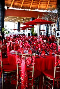 Red Orient Luxe Wedding, love the umbrellas in tall vases for centerpieces!