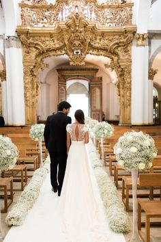 Church-Decorated with babys breath Love the back of this Elie Saab dress