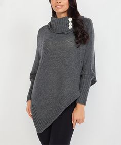 Fobya Graphite Wool-Blend Poncho | zulily  . $34.99 $89.00 size: size chart One Size Product Description:  Stay snug in this cozy wool-blend poncho, featuring long sleeves for extra warmth and a button accent at the neckline for a polished touch.  Size note: This item is from a European brand. Please refer to the size chart to ensure best fit.      Fits S-L     33.4'' long from high point of shoulder to hem     Knit     80% wool / 20% acrylic     Hand wash; hang dry     Imported