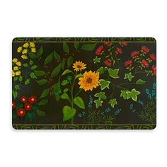 Colorful flowers on a black background adorn this pretty, go-anywhere mat. It'll serve as a no-slip spot, and cushioning for wet, tired or cold feet.