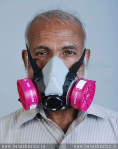Dr. Thomas donning a replaceable cartridge respirator suitable for wearing in the proximity of asbestos. #asbestosbanindia