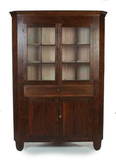 "Garths |  Lot 165 OHIO DECORATED CORNER CUPBOARD.  Xenia, Ohio, ca.1840, poplar. One-piece cupboard with dovetailed drawer. Twelve pane top over base with two doors. Original folksy grain paint. Nice cutout feet. Repainted interior. 82.5""h. 58""w. 28""d.  Estimate $ 900-1,500"